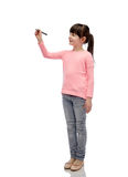 Little girl drawing or writing with marker Stock Photography