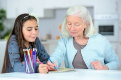Little girl drawing wuth grandma Royalty Free Stock Photography
