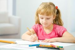 Little girl draws Stock Photography