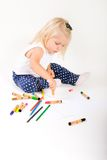 Little girl draws. Stock Image