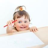Little girl draws Stock Image