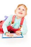 The little girl draws Stock Images