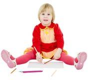 Little girl draws Stock Photo
