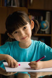 Little girl  draws. Child draws with color pens Stock Photos