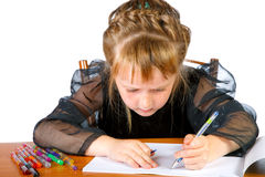 The little girl draws in an album Royalty Free Stock Photography