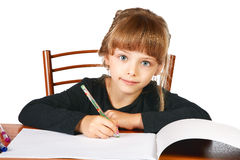 The little girl draws in an album felt-tip pens Royalty Free Stock Image