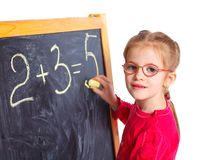 Little girl draws on the board Stock Photo