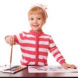 Little girl draws brush Royalty Free Stock Photos