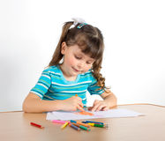 Little girl draws Stock Images
