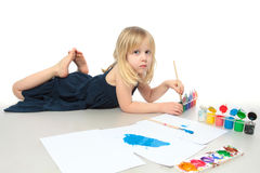 Little girl draws a colored paint Stock Image