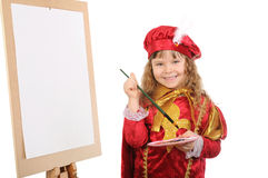 Little girl draws on easel. Royalty Free Stock Images