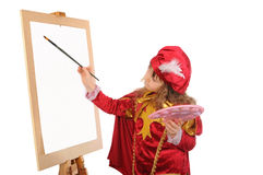Little girl draws on easel. Stock Image