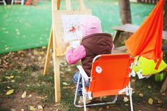 Little girl draws on the easel. royalty free stock photos