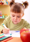 Little girl draws with felt-tip pen Stock Image