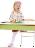 Little girl draws felt-tip pens Stock Photos