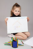 The little girl draws Stock Photography