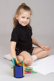 The little girl draws Stock Photos