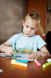 Little girl draws glass colors royalty free stock images