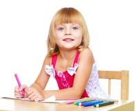 Little girl draws. Royalty Free Stock Photos