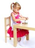 Little girl draws. Royalty Free Stock Photo