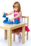 Little girl draws. stock image