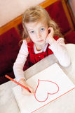 Little girl draws heart. Valentine's Day Stock Images