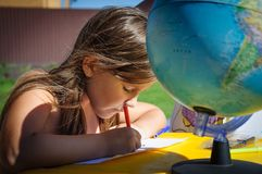 Little girl draws markers outdoors in summer stock photos