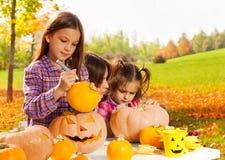 Free Little Girl Draws On Halloween Pumpkin Stock Image - 72936271