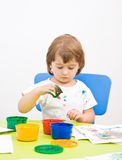 Little girl draws paint Royalty Free Stock Image