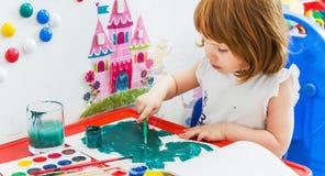 Little girl draws paints stock video