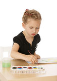 Little girl draws paints Royalty Free Stock Photography