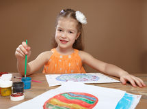 Little girl draws paints in kindergarten Royalty Free Stock Photos