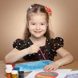 Little girl draws paints in kindergarten Stock Photography