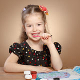 Little girl draws paints in kindergarten Royalty Free Stock Photography