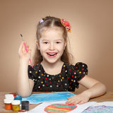 Little girl draws paints in kindergarten Royalty Free Stock Images