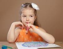 Little girl draws paints in kindergarten Stock Image