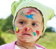Little girl draws paints. On a green lawn Royalty Free Stock Images