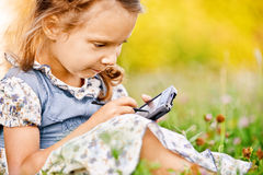 Little girl draws on PDA Stock Photography