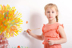 Little girl draws a picture Royalty Free Stock Images