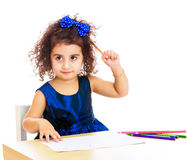 Little girl draws at the table with pencils Royalty Free Stock Image