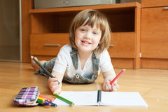 Little girl draws Stock Photos