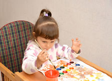 The little girl draws water color paints Stock Image