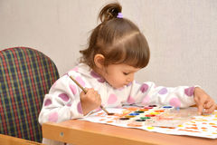 The little girl draws water color paints.  royalty free stock image