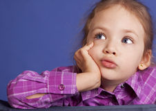 Little girl dreaming royalty free stock image