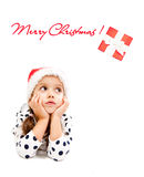 Little girl dreaming about christmas Stock Images