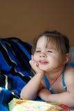Little girl dreams Stock Photo