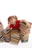 The little girl dreams on books royalty free stock images
