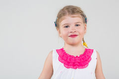 Little girl in dress with hairgrips in hair Stock Photo