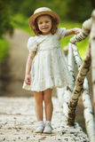 Little girl in a dress and hat Royalty Free Stock Photography