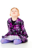 A little girl in a dress, have fun, sits Stock Photo